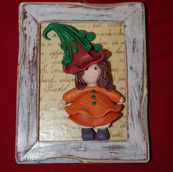 Cold porcelain doll with wood frame
