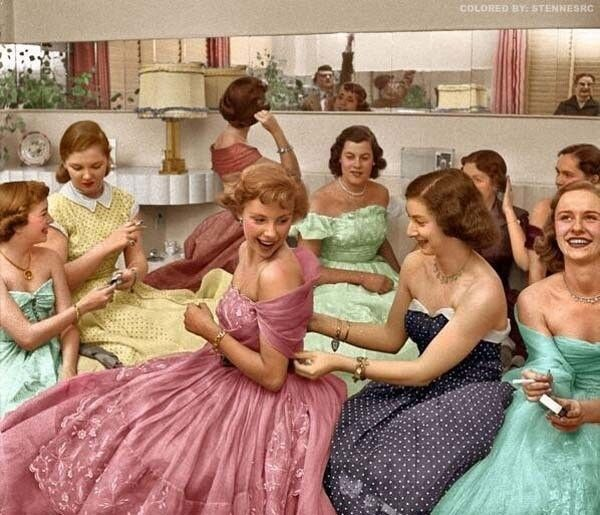 Young women attend a house party in this colorized photo (1950s).  WL