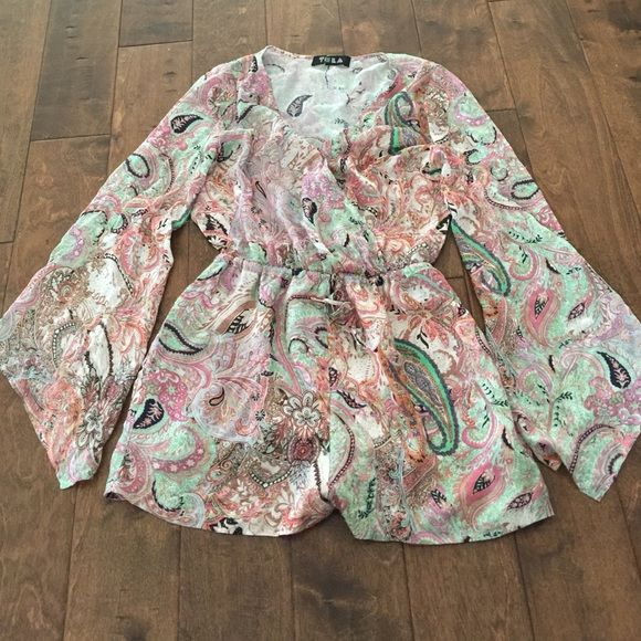 Urban Outfitters Tela Paisley Bell Sleeve Romper Urban Outfitters Tela Paisley Bell Sleeve Romper new never worn. Tag is cut to prevent store return. Snap closure at the top soft flowy material. Urban Outfitters Pants Jumpsuits & Rompers