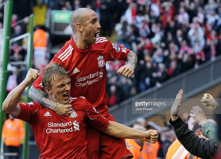 Dirk Kuyt of Liverpool celebrates his third goal with Raul Meireles during the Barclays Premier...