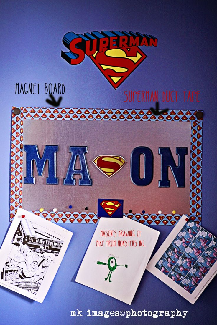 Superman Room Superman Bedroom Metal Magnet Board.  Wooden blue letters with magnets and a superman belt buckle for the S in Mason.  I used Superman duct tape for the edging.
