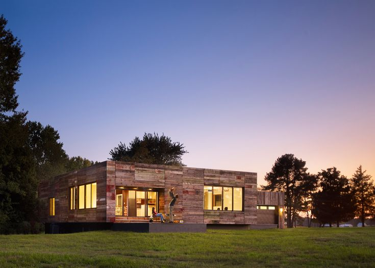 DIGSAU uses reclaimed barn wood to clad modern home in Delaware