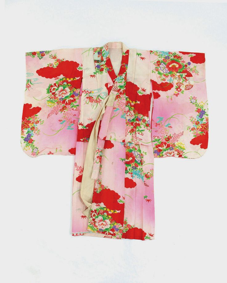 This is a colorful children's Kimono, made to wear for celebrations. It is thin silk, easy to tie closed, and it features bright, vibrant patterns. This is a girl's Furisode, long-sleeve Kimono. It ha