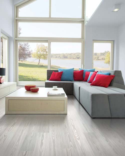 We love the look of this light Pergo Max Premier Willow Lake flooring with open windows and pops of color.