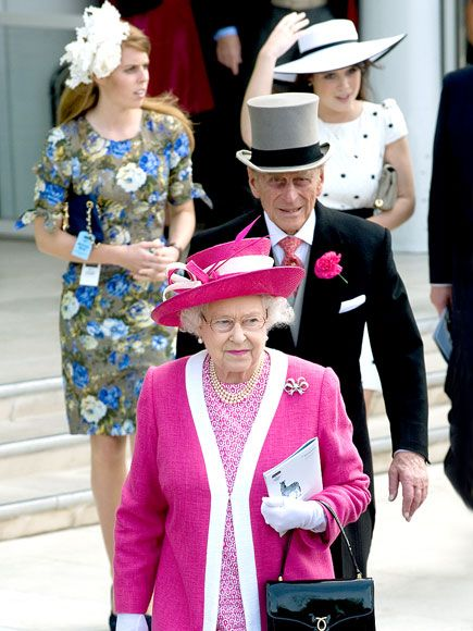 ALL HAIL THE QUEEN  Queen Elizabeth II and Prince Philip – sporting a fuchsia flower to match his wife's pink ensemble – head into the Epsom Derby, where her horse, Carlton House, was a favorite to win the race.