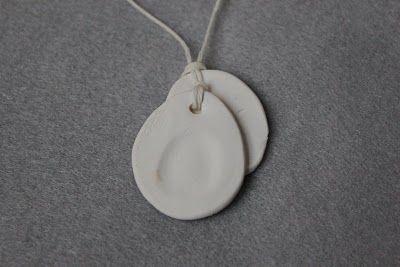 Thumbprint pendants.