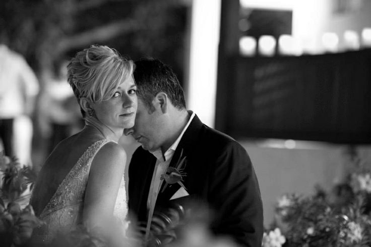 A stolen moment caught on camera during a Barbados wedding. Photography by Mark Bushkes