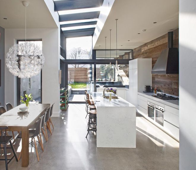 Love this Irish Kitchen by Optimise Design! Reclaimed barn wood on wall mixed with modern cabinets and dining area.