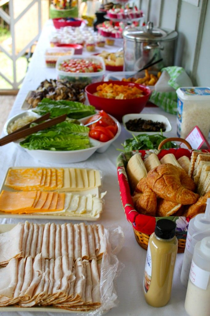 A healthy table spread. This one specifically is to  make turkey sandwiches with deli meat and cheese, but you can make this a salad bar, too. Good for large groups or the family.
