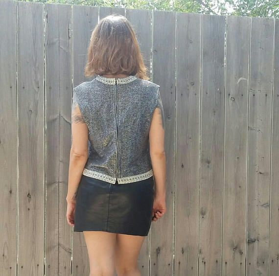 Check out this item in my Etsy shop https://www.etsy.com/listing/546061165/1960s-vintage-metallic-silver-sleeveless