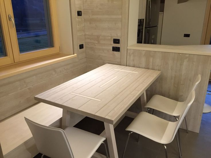 """Dining room with the table """"New Fratino"""", the piece we created trying to get back to the traditional lines of refectory tables."""