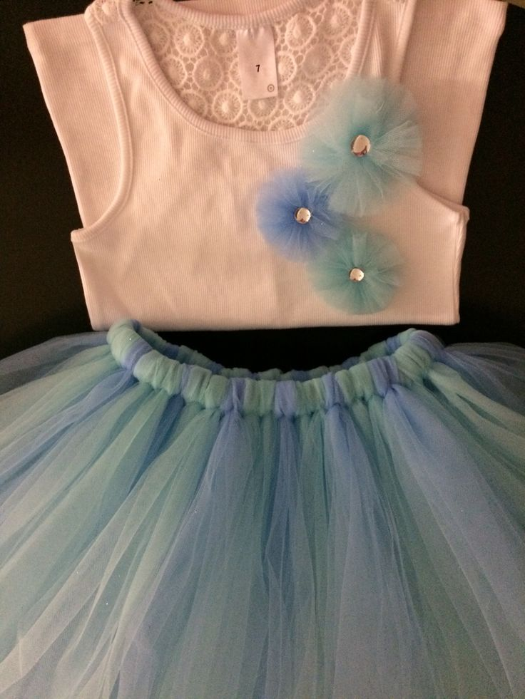 Knee length tutu paired with a singlet with tulle flowers