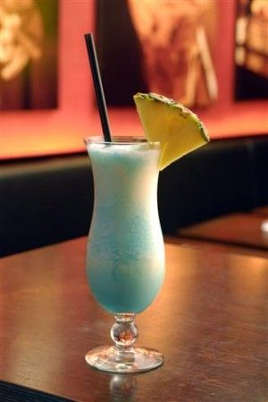 Swimming Pool ~ 1/4 oz Bols Blue Curacao 1 1/2 oz White Rum 3/4 oz Vodka 2 oz Pineapple Juice 3/4 oz Coconut Cream 1/4 oz Cream