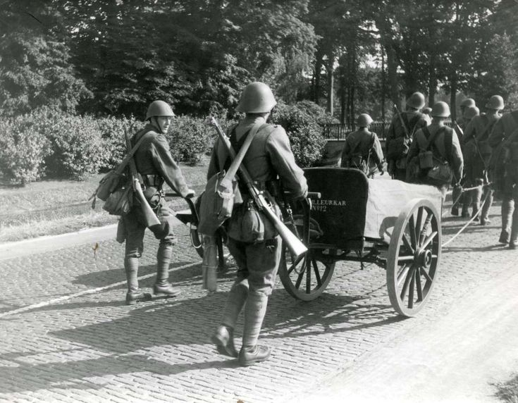 Dutch soldiers pushing a bakers cart