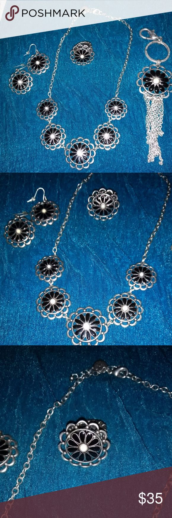 Grace Adele Set Beautiful Grace Adele set.  Necklace, Earrings, Ring and Key Fob.  Black daisy's in silver flower design.  The ring is stretchy so should fit most comfortably.  Worn only a few times. Grace Adele Jewelry Necklaces