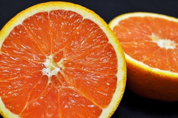 Cara Cara Navel Orange displays a bright orange peel, similar to other navels. Cut it open and you'll notice its distinct pinkish-red flesh..