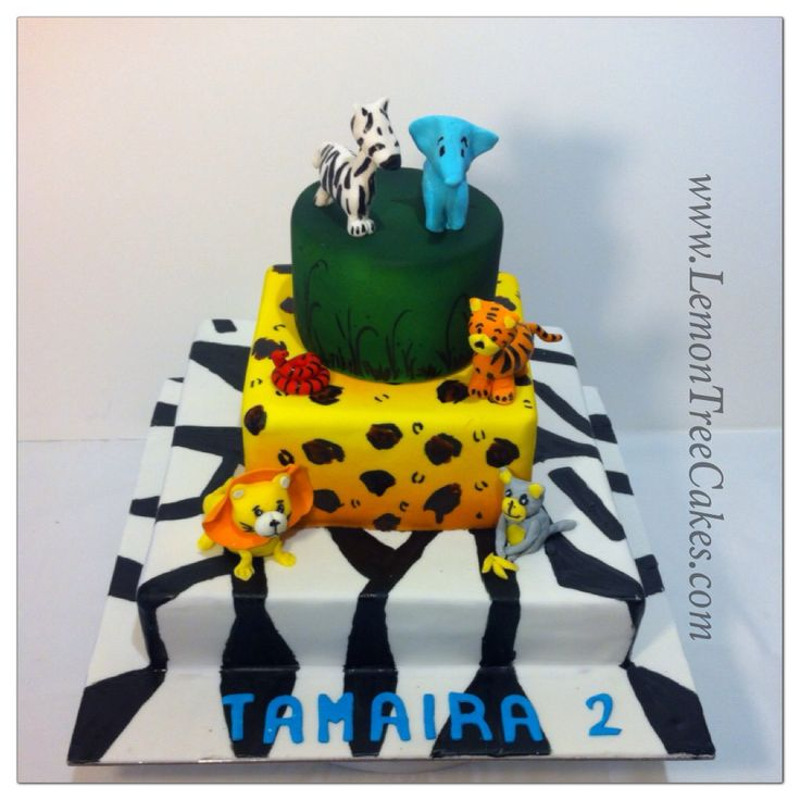 Jungle theme cake.... Inside chocolate mud, layers are airbrushed and then hand painted...animals are all edible...
