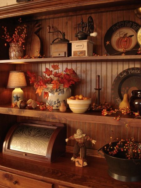 I love how this hutch is decorated for fall. Bakers rack idea???