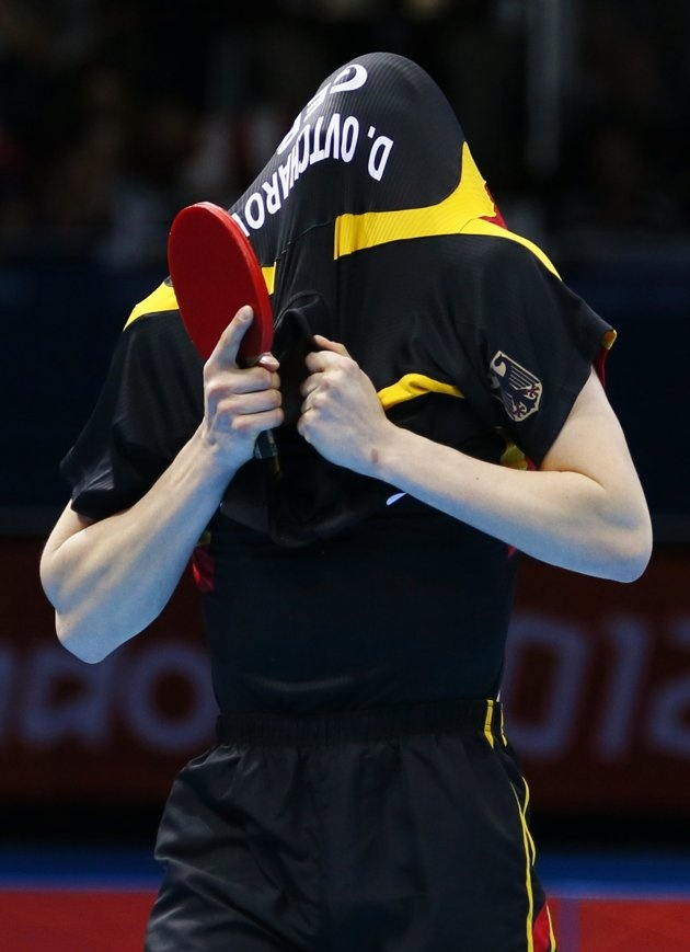 Germany's Dimitrij Ovtcharov celebrates after defeating Denmark's Michael Maze in their men's singles quarterfinals table tennis match at the ExCel venue during the London 2012 Olympic Games July 31, 2012. REUTERS/Kai Pfaffenbach