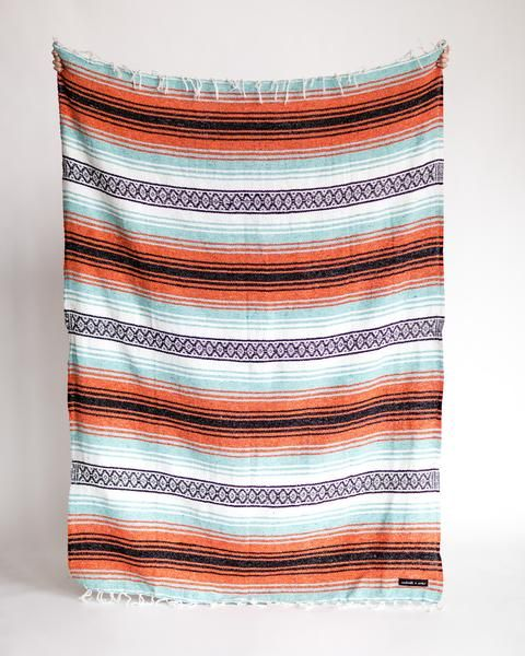 "By purchasing this blanket, you will also be providing a blanket to your local homeless shelter. Size: 72"" x 52"" Weight: 2.5 lbs Care Instructions: Wash Cool- h"