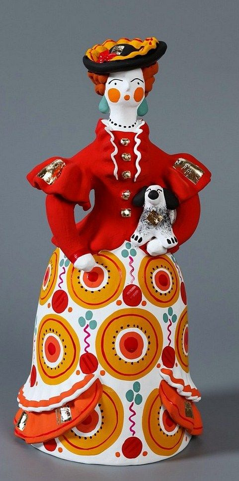 Dymkovo toy is a painted clay toy from the Russian village of Dymkovo. Lady with a small doggy.