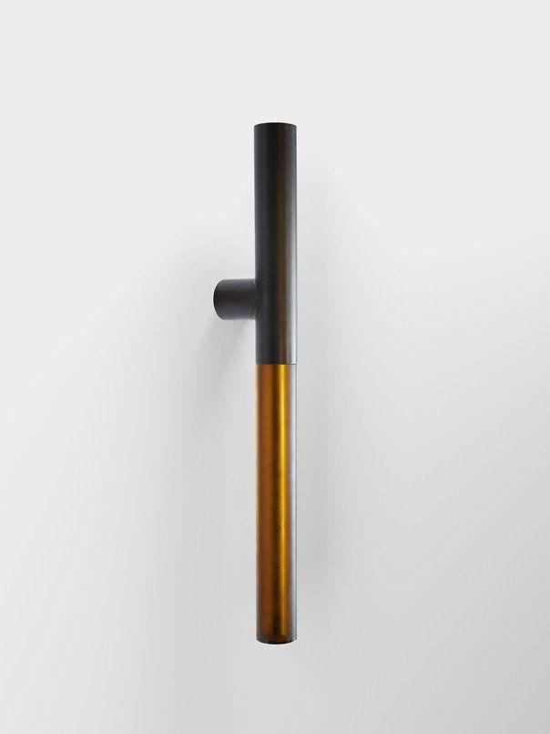 "Tom Kundig Collection Designed by: Tom Kundig Welded steel tube door pull with transparent cast resin grip, 2""OD x 24""h...."