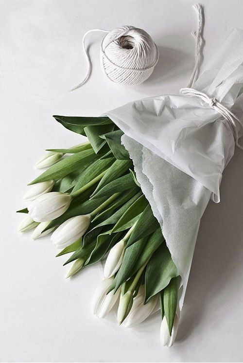 There is something so crisp and clean about a bunch of white tulips.  I would put these in a large white milk jug.