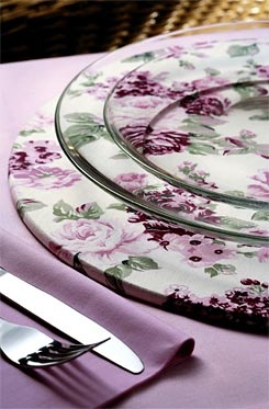 Clear plates on a floral placemat