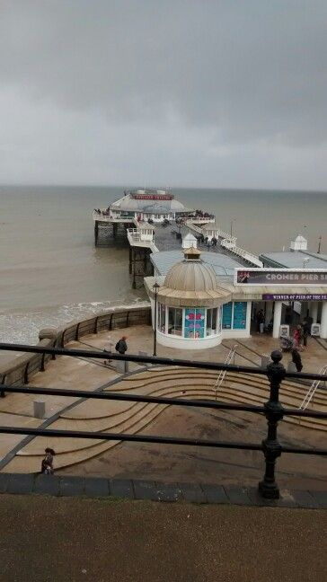 Cromer pier with rainclouds approaching.