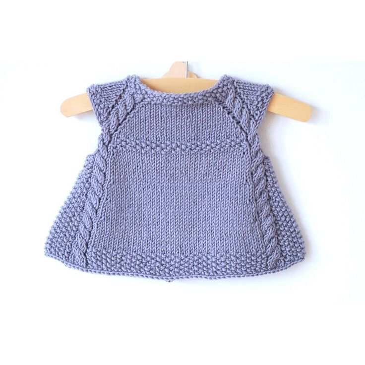 This charming cabp-sleeved, swingy cardigan is the perfect timeless piece to add to any little girl's summertime wardrobe, or as an extra layer in the Fall. Lovely over a crisp white dress, it is also comfortable enough to be paired with everyday play clothes.The cables and seed stitch create a sophisticated, rich texture that is designed to showcase yarns with great stitch definition.Construction: This cardigan is knit seamlessly from the top down. Stitches for the cap sleeves are bound…