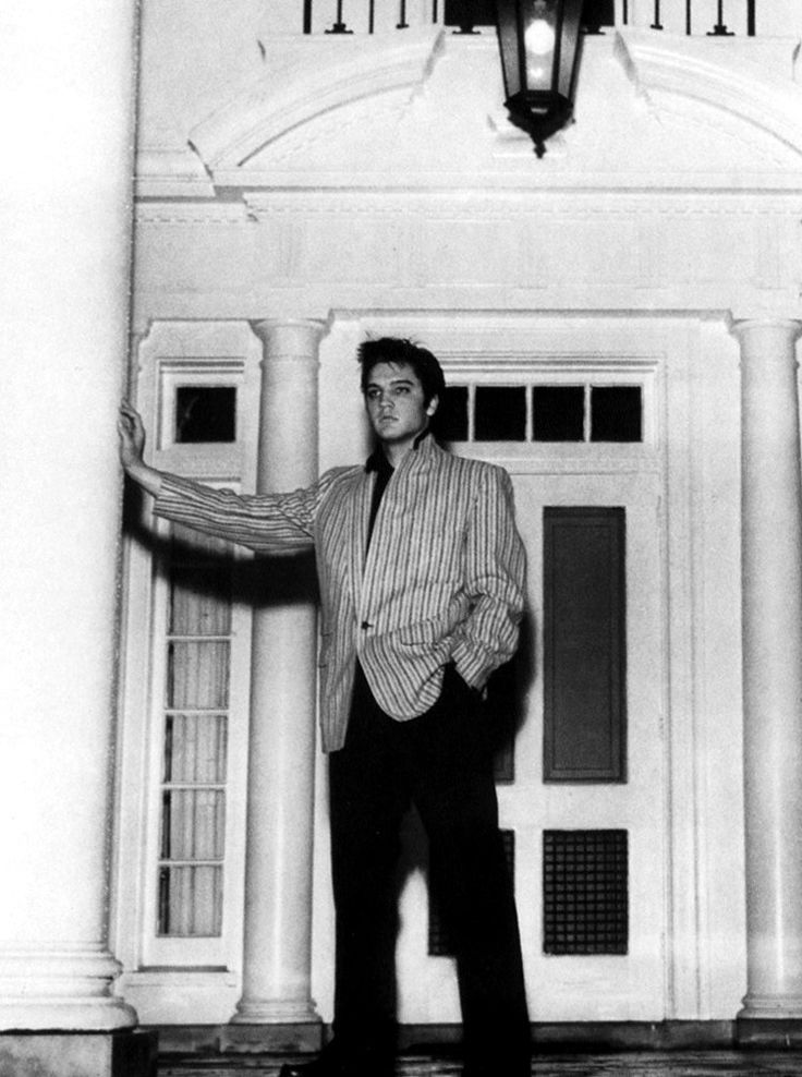 A Classic Picture Of Elvis In The Front Porch Of His Brand