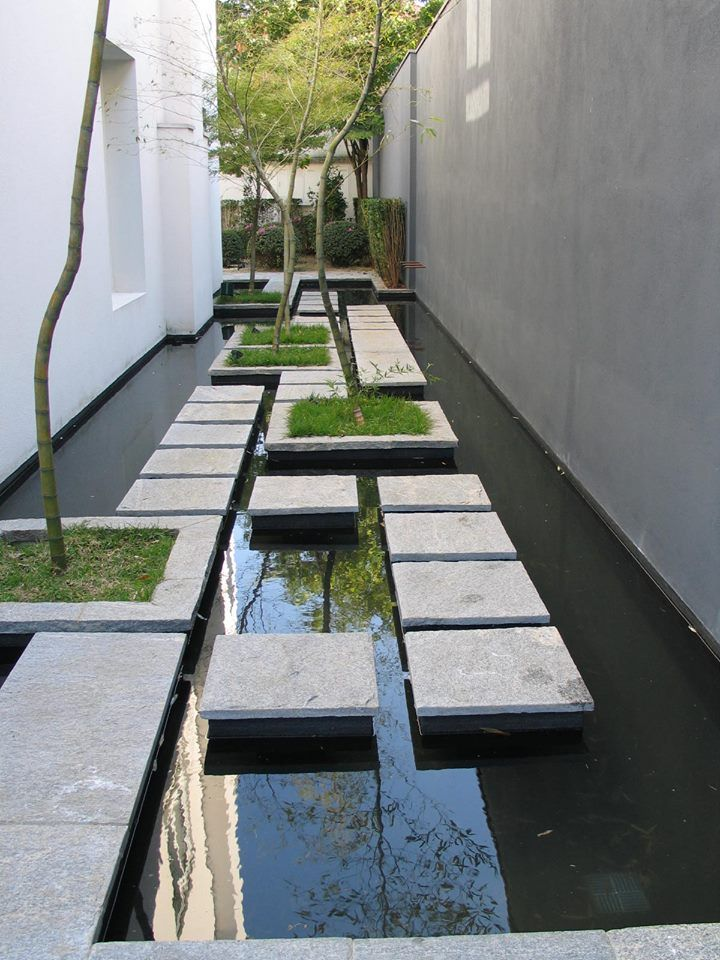 floating slabs make a paved water feature | adamchristopherdesign.co.uk