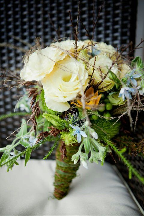 Its all in the detail. Bridal bouquet with blue tweedia, lissianthus, green trick, tiny sunflower, rhisteo flower and nz native foliage kahikatea and rimu by febella flowers