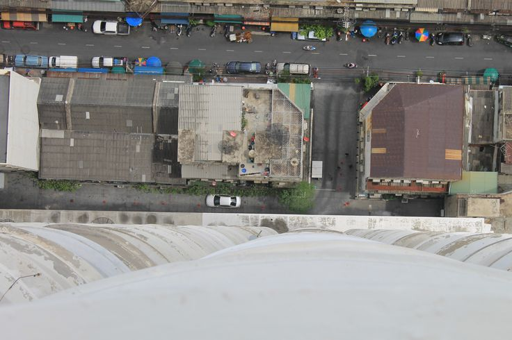 52 floors up and looking straight down from the balcony at Bangkok below. Its a long way down