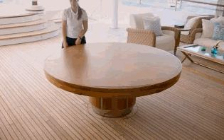 this is an amazing bit of engineering - a dining table that doubles in size just beautifully