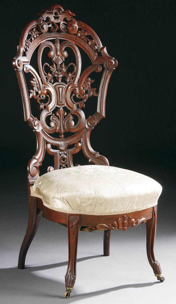 An American Rococo Laminated Carved Rosewood Slipper Chair, attributed to J. W. Meeks.