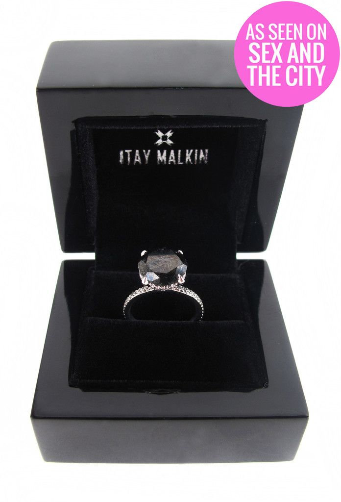 This is Carrie Bradshaw's ( Sarah Jessica Parker) 5 carat black diamond engagement  ring with a 18 karat white gold band, that she received from Mr Big (Chris Noth) in the Sex And The City 2 (2010) movie! You can get the ring straight from the shop of the iconic costume designer Patricia Field… but… ouch… it costs $10,000…