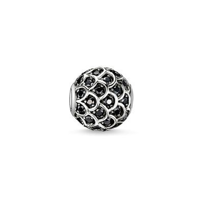 THOMAS SABO Karma Bead from the Sterling Silver Collection. Black fish - 925 Sterling silver, blackened - black zirconia Size: ca. 1,1 cm A tank-like cloak of scales made from black zirconia lends its wearer protection and makes the BLACK FISH KARMA BEAD crafted from 925 Sterling silver sparkle magically.