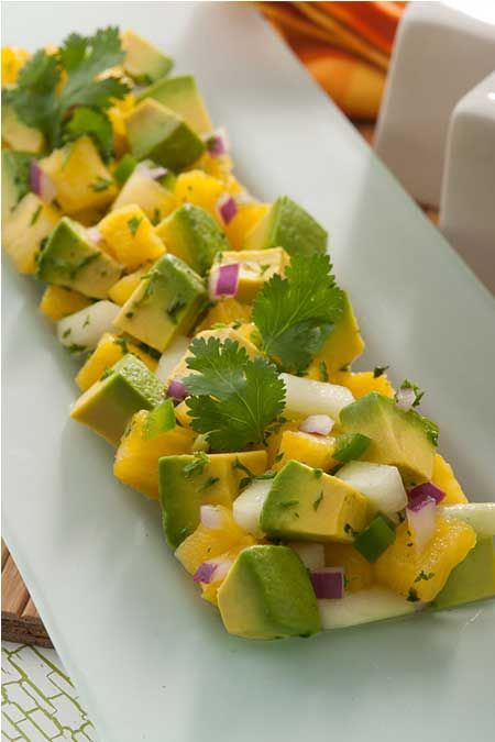Get the party started with this amazing Avocado and Pineapple Salad! It's the perfect mix of sweet and tangy that goes great with a savory steak or burger.