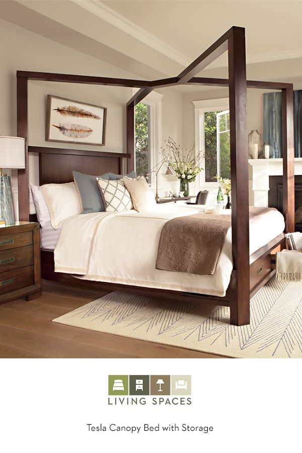 Wake up to beautiful surroundings in the Tesla Canopy Storage Bed. Crafted in hardwood and veneer in a warm walnut finish, the charming, two-drawer piece features clean lines and understated hardware that lend sophisticated simplicity, creating a commanding yet inviting foundation for your bedroom. Find it in queen, california king, and eastern king at LivingSpaces.com.