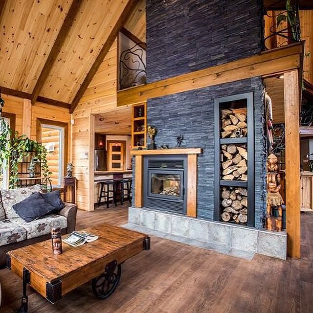 What a home this is...Timber Block truly builds some of the most beautiful insulated log homes! We love the inside of this log cabin. With the darker stained beams, to the beautiful wood floors. And how about that fireplace? We are absolutely in love with the double sided fireplace-in the center of the room. More at www.timberblock.com