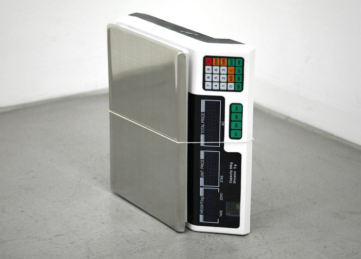 JASON DODGE, Scale, 2011, There is a scale, which turned on it's side becomes the object of gravity itself as opposed to the measure of gravity.