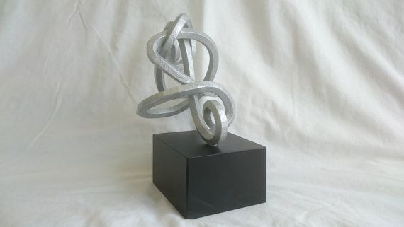 Check out this item in my Etsy shop https://www.etsy.com/uk/listing/238592798/twisted-cleff-sculpture-3d-printed-in