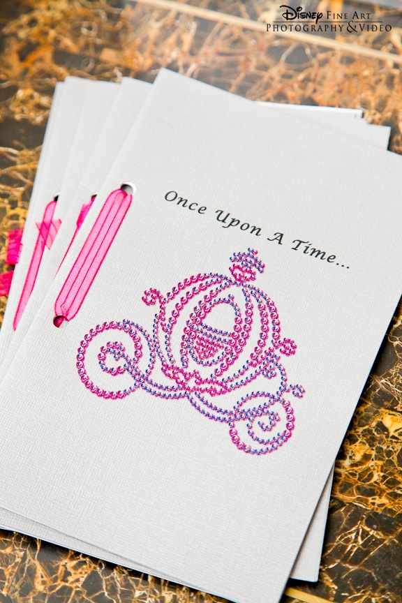 "Maybe use this idea and add a collection of colouring in pages and add each girls name so they have their own 'book' and they can also take it home? ie Princess Evie...""Once Upon A Time..."" custom wedding programs with Cinderella's Coach"