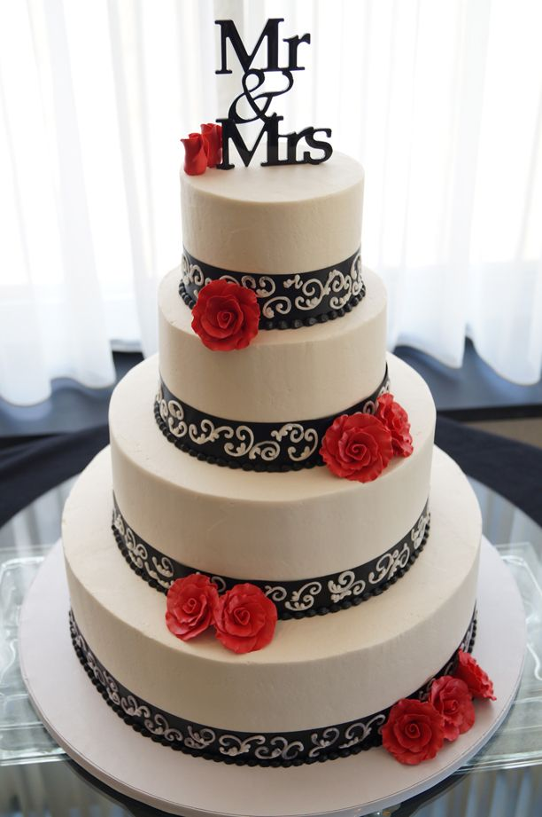 Striking Black, white & red wedding cake by Steel Penny PA  This is really pretty. Gerber daisies instead and it's the perfect gamecock colored wedding cake.