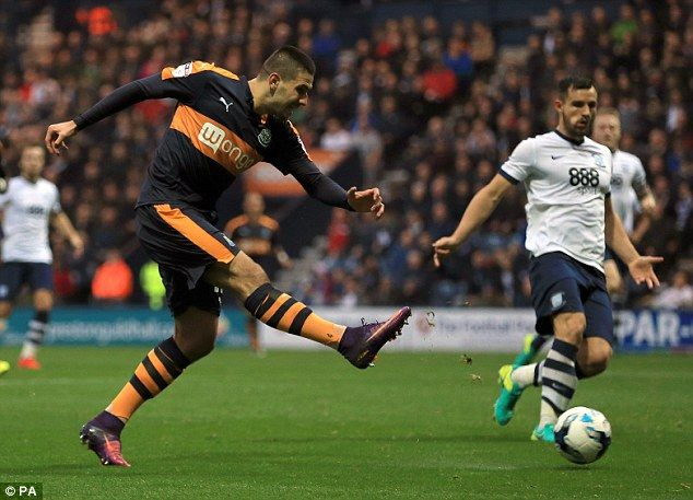 Mitrovic puts his foot through the ball to put Newcastle in front on 59 minutes at Deepdale