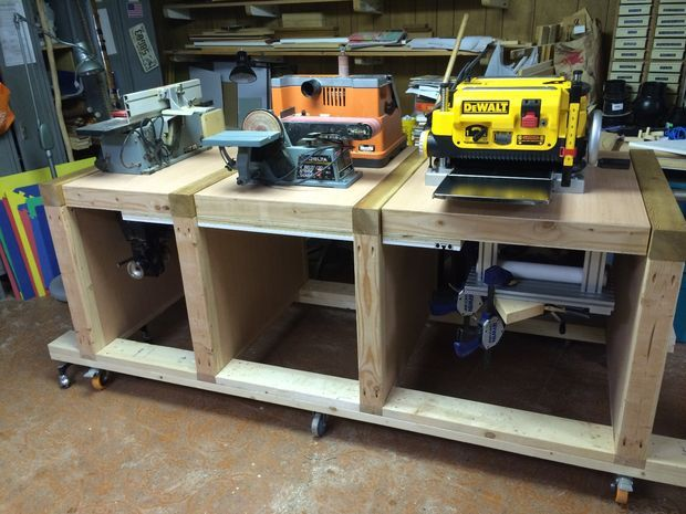 Multi-Tool Flip-Top Table. Each of the three work surfaces can be flipped over to use another mounted tool, for a total of six different workstations. Additional tools are organized on the ends.