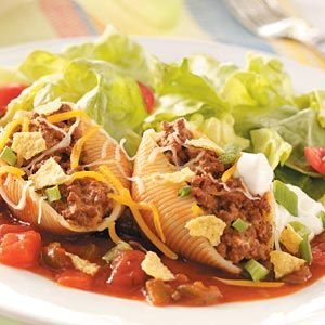 Taco-Filled Pasta Shells Recipe -I've been stuffing pasta shells with different fillings for years, but my family enjoys this version with taco-seasoned meat the most. The frozen shells are so convenient, because you can take out only the number you need for a single-serving lunch or family dinner. Just add zippy taco sauce and bake. —Marge Hodel Roanoke, Illinois