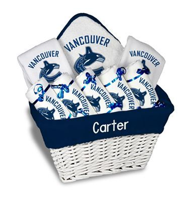 Our Personalized Vancouver Canucks Large Gift Basket is a perfect baby gift with 5 burp cloths 2 bibs and a towel personalized with the Canucks logo.