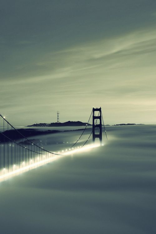 Golden Gate Bridge peeking through fog and spray: San Francisco magic!